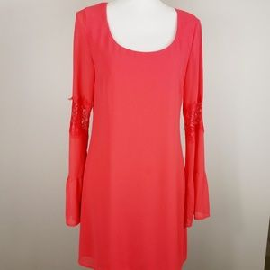Accidentally In Love coral bell sleeve mini dress
